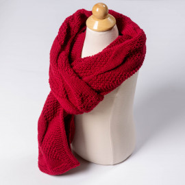 Soft red hand-knitted wool scarf