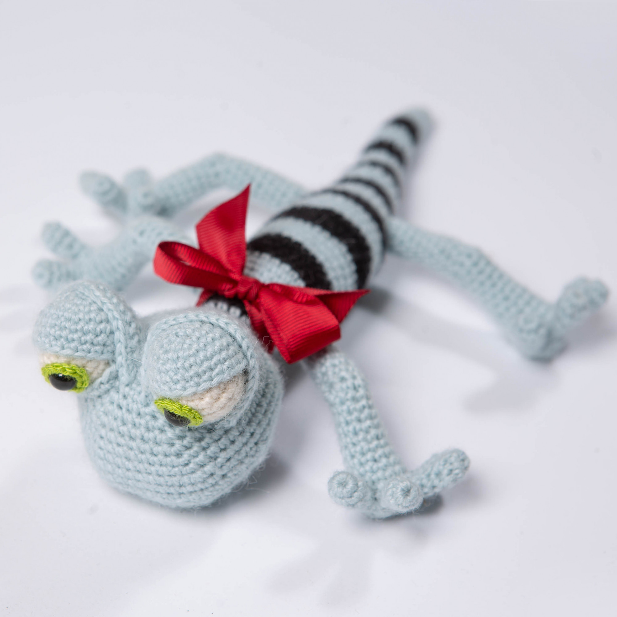 The lizard is a toy for a kid. Blue funny reptile