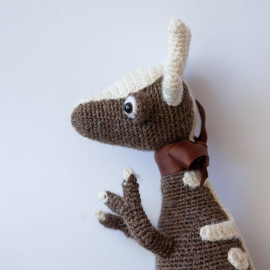 Dinosaur Toy. Soft toy for baby of the Jurassic period. Funny dino