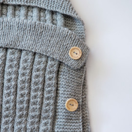 Hand-knitted envelope for newborns. Warm envelope for a walk
