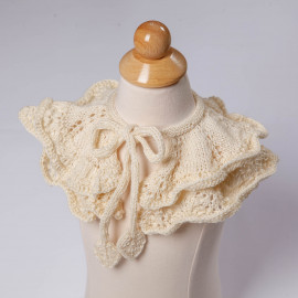 Openwork knit cape. Beige cape for the shoulders for the girl.
