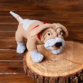 Toy dog. Crochet dog. Hand-knitted toy for children