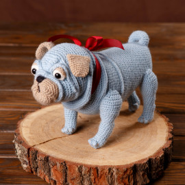 Toy dog. Toy pug. A dog is the best gift for a child