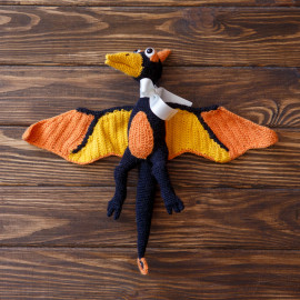 Hand crocheted toy, Orange Pterodactyl, the earliest bird