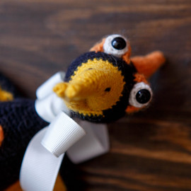 Hand crocheted toy, Orange Pterodactyl, the earliest bird